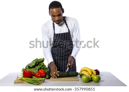 African American male chef wearing an apron cooking isolated on a white background - stock photo