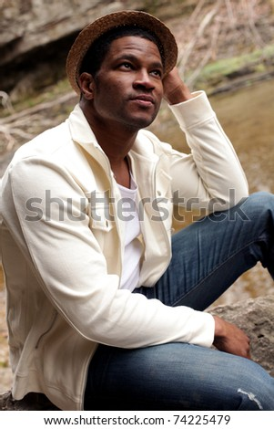 African American Male in nature looking up to Sky - stock photo