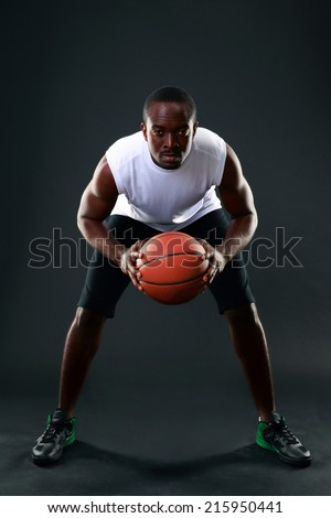 African American male playing basketball - stock photo