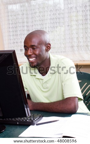 african american male student learning computer - stock photo