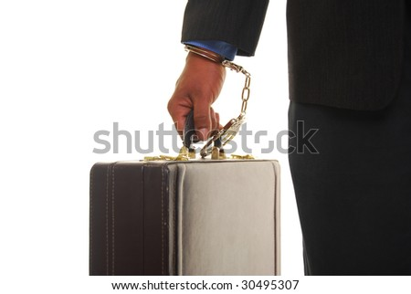 African american male wearing a business suit handcuffed to a briefcase. - stock photo