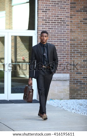 African american man boy adult, fashion black man, looking to camera, business man, man in suit, sitting man, have a sit, young man in suit, garb, costume, fashion back model, boyfriend, united states - stock photo
