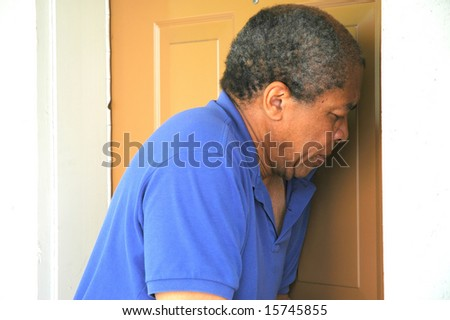 African american man breaking into a house. - stock photo