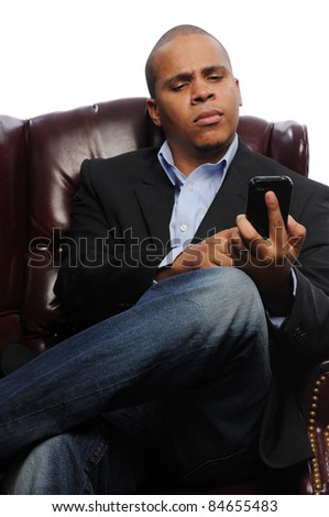African American Man dialing on Cell Phone - stock photo