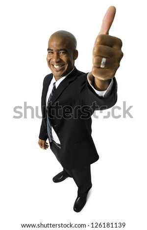 African American man giving thumbs-up signal on white background