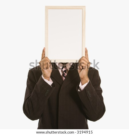 African American man holding blank sign over his face standing against white background. - stock photo