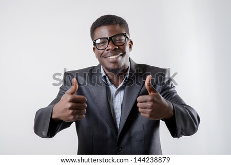 African-American man holding two thumbs up - stock photo