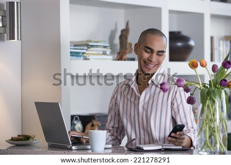 African American man looking at cell phone - stock photo