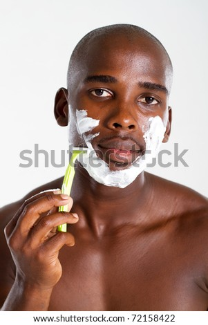 african american man shaving - stock photo