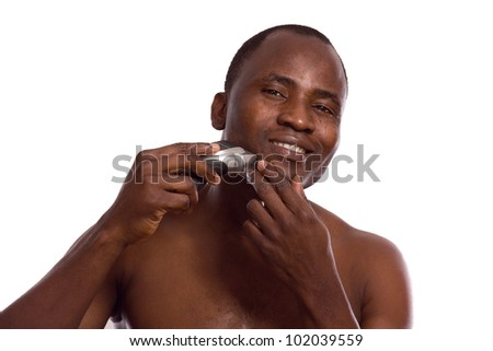 African-american man shaving, isolated on white background - stock photo