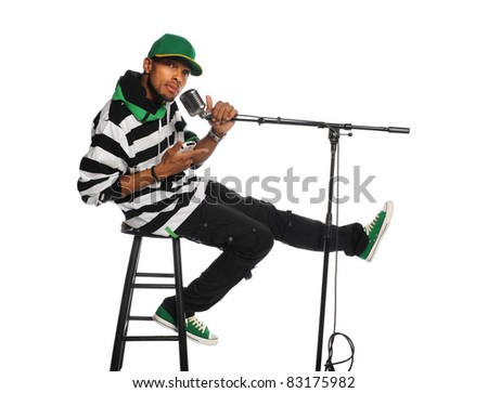 African American man singing into vintage microphone isolated over white background - stock photo