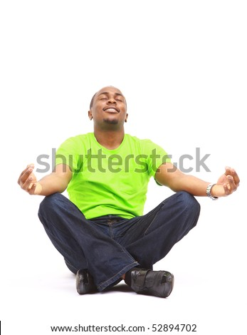 African American man sitting in yoga position on white background - stock photo