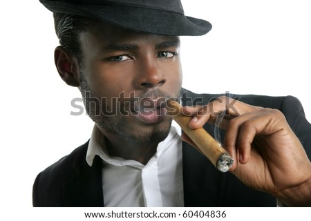 African american man smoking cigar portrait with black hat - stock photo