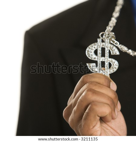 African American man wearing necklace with money sign. - stock photo