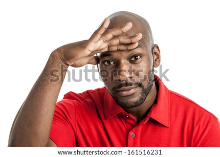 African American man with hand over eyes looking out isolated on white background