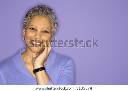 African American mature adult female smiling looking at viewer. - stock photo