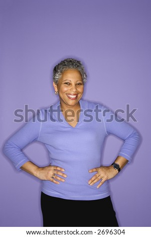 African American mature adult female standing smiling. - stock photo