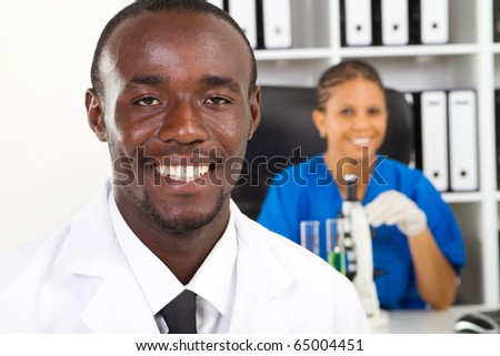 african american medical researchers in lab - stock photo
