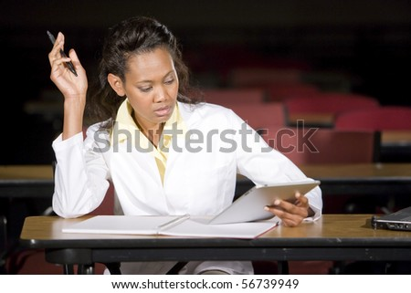 African American medical student studying at night in classroom - stock photo