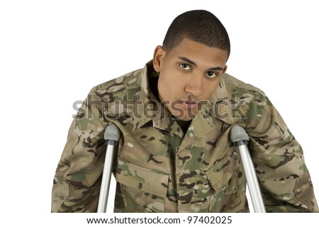 African American Military Man on Crutches - stock photo