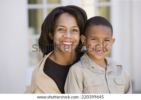 African American mother and son smiling - stock photo