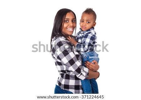 African American mother holding  her little son isolated on white background - stock photo