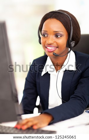 african american online support operator using computer - stock photo