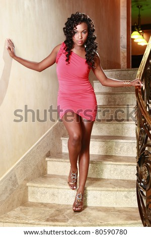 African American poses at a stairway - stock photo