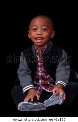 African American poses on a black background with a big smile - stock photo