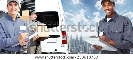 African-American postman. Delivery and shipping background - stock photo