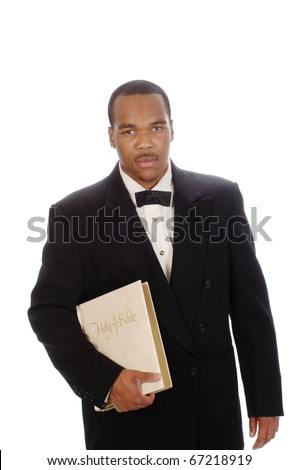 African American preacher holding a bible, isolated over white - stock photo