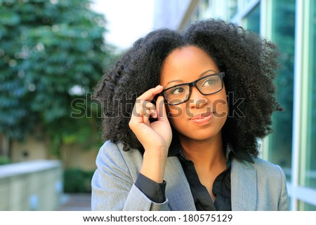 African American Professional Business Person Pretty Beautiful Wearing Black Shirt and Suit Smiling Wearing Glasses and Thinking - stock photo