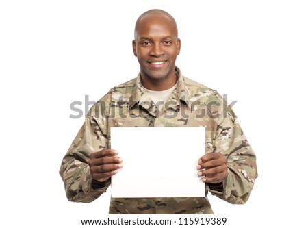 African American serviceman holds a sign - stock photo