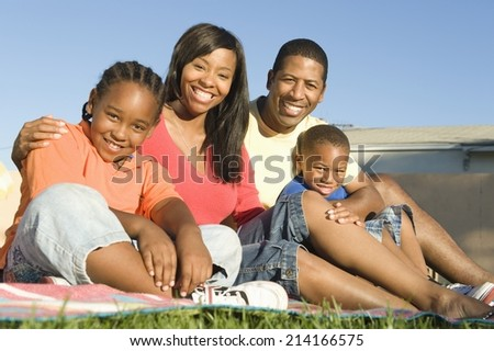 African American Sitting Outdoors - stock photo