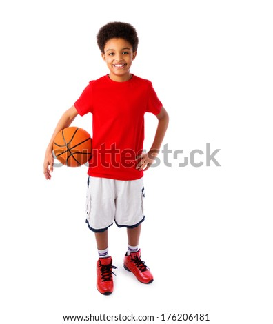 African American smiling teenager, basketball player posing with a ball in his hand isolated on white background. Full body portrait.  - stock photo