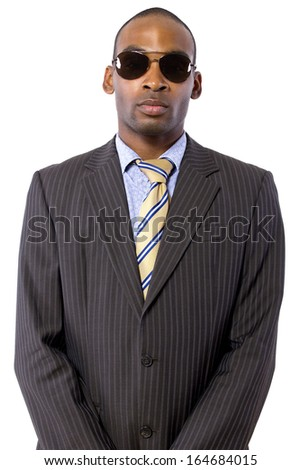African American spy or bodyguard in a suit and tie - stock photo