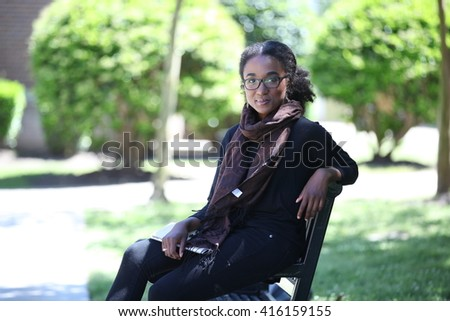 African American student girl, beautiful girl adult, with glasses, campus, outside, school girl outside, cute black young girl, smile, education, university, unites states, laptop, homework, glasses