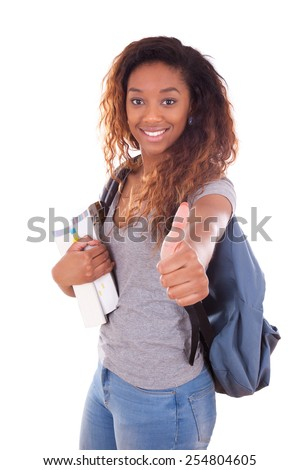 African American student girl holding books making thumbs up sign - Black people - stock photo