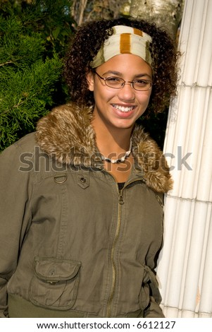 African american teen girl in a park setting - stock photo