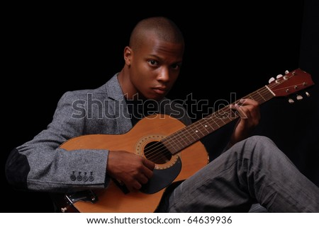 african-american teen playing the guitar - stock photo