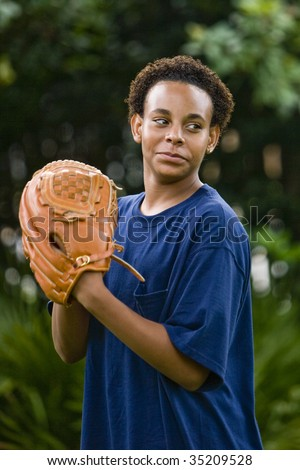 African American teenage boy playing baseball - stock photo