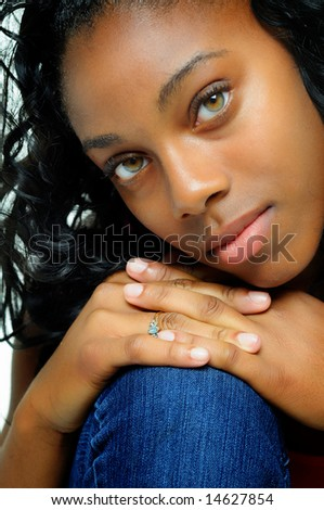 African American Teenage Girl Close Up With Beautiful Eyes - stock photo