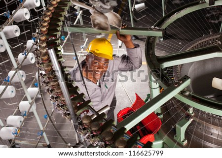 african american textile worker in factory - stock photo