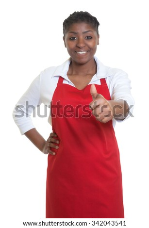 African american waitress showing thumb up - stock photo