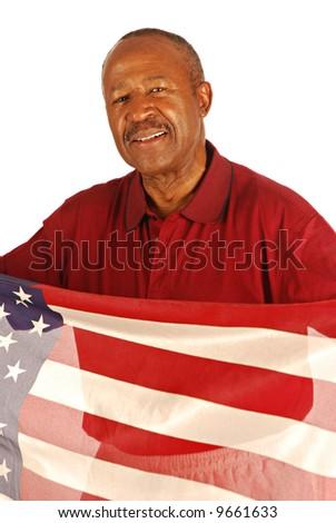 African American war veteran holding an American flag - stock photo