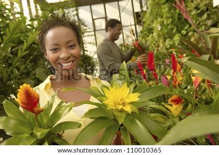 African American woman at botanical garden - stock photo