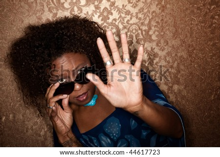 African American woman caught in a Paparazzi photographer's flash - stock photo