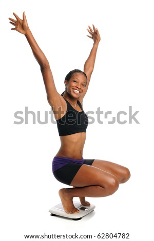 African American woman cheering on scale isolated over white background - stock photo