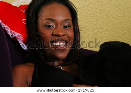 african american woman close up portrait of her relaxing on the sofa