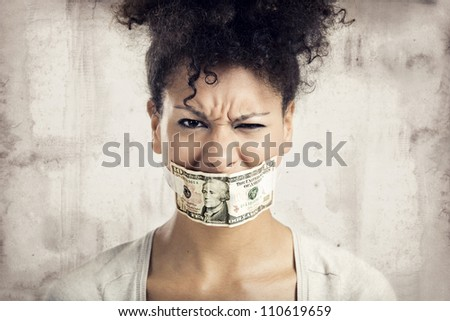 African American woman covering her mouth with a dolar banknote, great concept for the global crises - stock photo